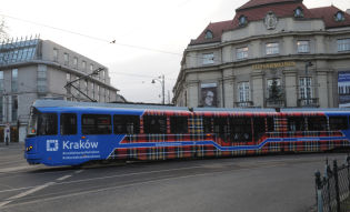 A tartan tram on the streets of Kraków